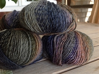 Wool fiber yarns blended with other natural and synthetic fibers